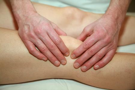 Mr Gilly Arbuckle Osteopath treating knee pain